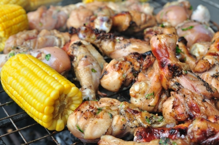 Chicken thighs and sweet corns be ripe by flaming on the sieve  photo