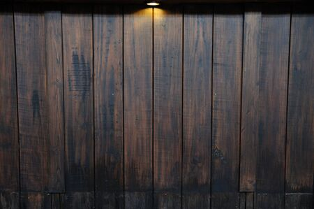 Ray light on antique wooden wall photo