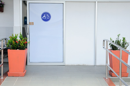 Toilets for disabled people and flowerpots Stock Photo