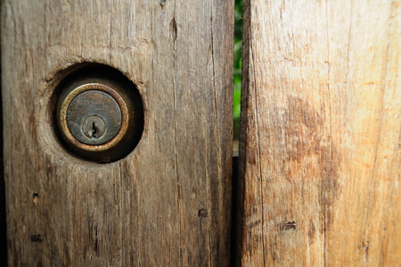 Close up brown wooden fence with  key-hole  photo