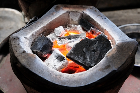 stoking: charcoal-brazier with charcoals fired
