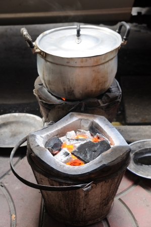 charcoal-brazier fired and cooking pot