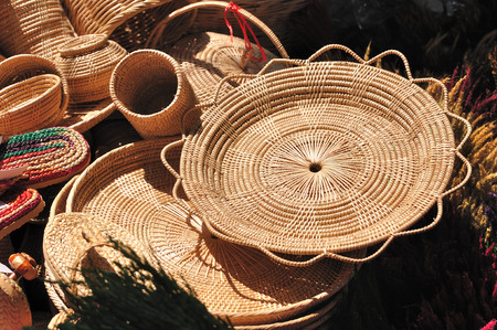 rattan mat: Various rattan containers put for sale in market fair.