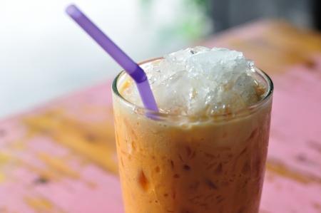 Thailand beverage, cold-milk-tea on painted desk