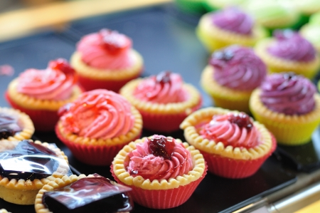 Colorful tarts selling in shop  photo