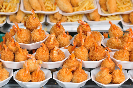 fished: Fried Shrimp and fished with French fries put in bowl foam
