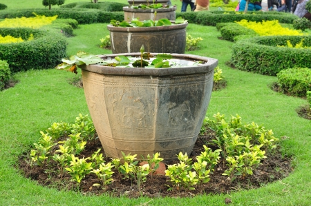 Big Chinese plant pots in public garden photo