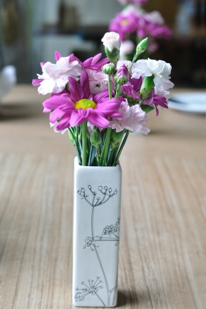 Beautiful flowers on wooden table  photo