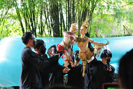 BANGKOK DEC 04  Unidentified Thai puppeteers are showing the Thai literature RAMAYANA-Chapter HANUMAN chasing mermaid on December 04, 2013 at Baan-si-la-pin Bangkok, Thailand