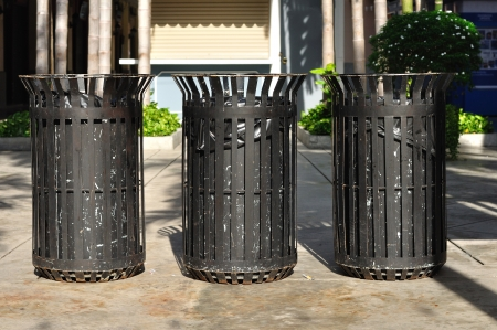 Three black iron bins in public street  photo