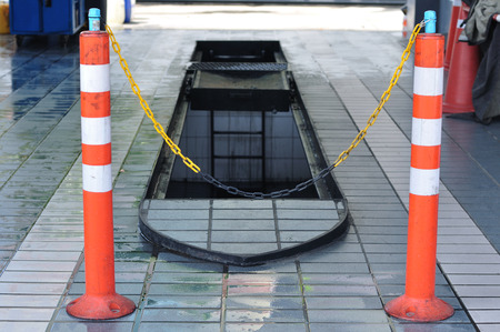 open trench: Oil engine pit closed by orange traffic-cones