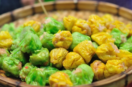 Many Chinese steamed dumpling in wooden basket