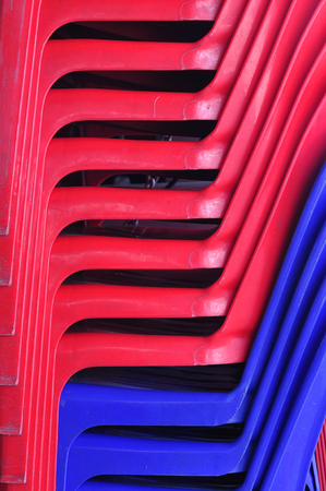 Pattern from red and blue plastic chairs  photo