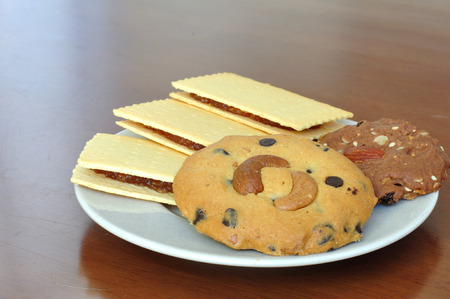 Many cookies type in white plate photo