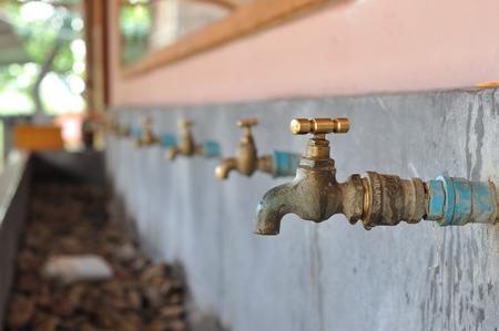 watertap: Many brasses water-tap in sink  Stock Photo