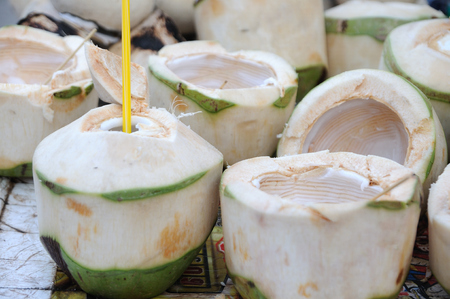 Many stack of empty coconut at market fair, Thailand