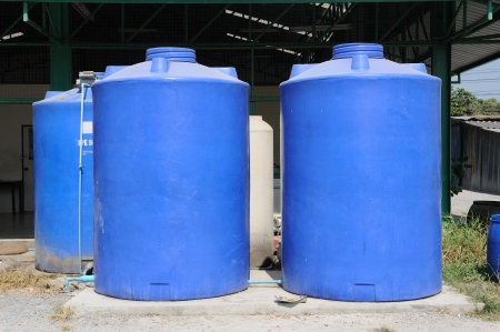 Big blue water plastic tank  photo