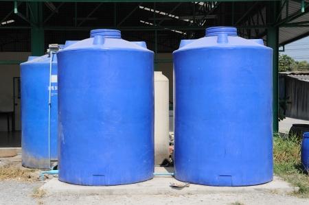 Big blue water plastic tank