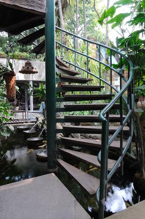 winder: Front of winder stair in garden.