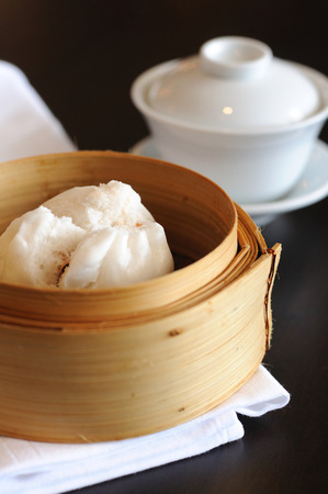 Type of Chinese Steamed Bun with tea cup.