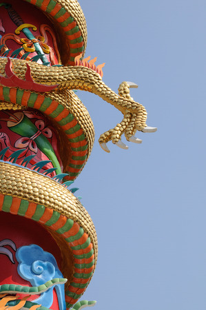 festival scales: Part of dragon statue with blue sky Stock Photo