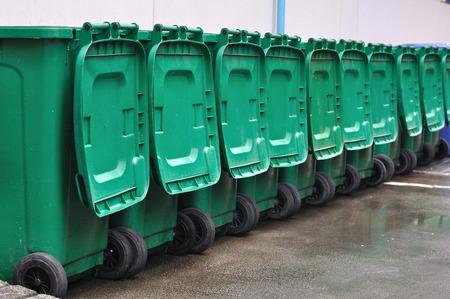 Many green bins arrange out door. Stock Photo