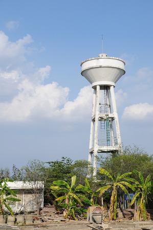 Single white big cement water tank. photo