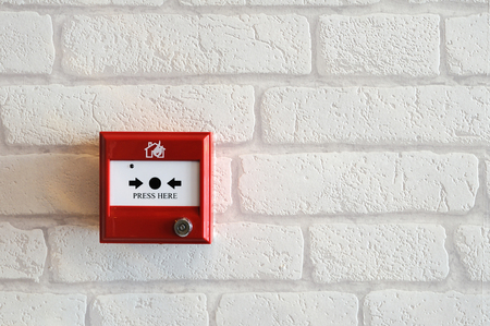 Fire alarm red box stick on with brick wall photo
