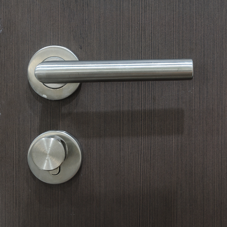 Modern door handle and lock. photo