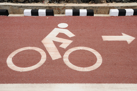 Sign of bicycle lane with arrow direction. photo