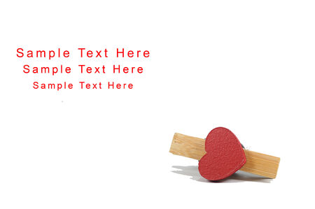 peg board: Clothes peg with heart on white background, conception.