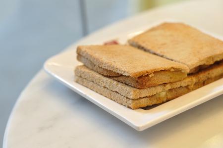 Many crispy bread on white plate