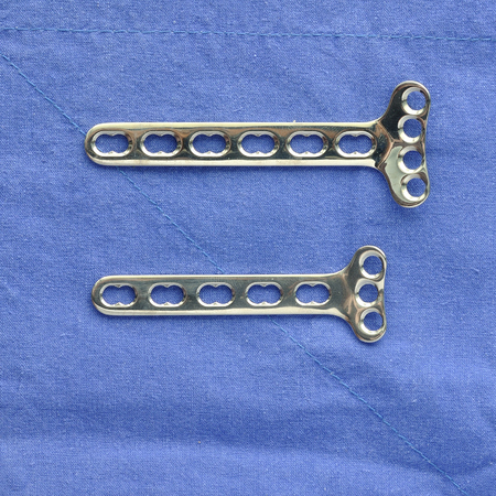 Many type of  surgery-plates straight and narrow on blue cloth