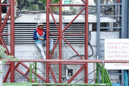 scaffolds: BANGKOK-Nov 01: Unidentified worker climbing girder to complete his work on November 01, 2014 Bangkok, Thailand. Editorial