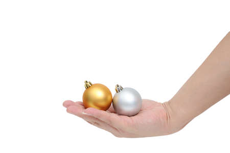 x mas: Asia man hand holding X Mas ball, isolated on white background with clipping path