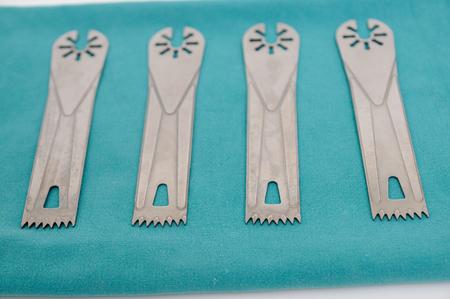 blades: Surgery oscillating saw blades on green cloth.