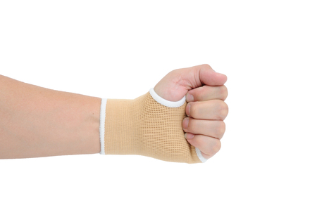 carpal tunnel syndrome: Man hand with wrist-support protection on white background, body action.