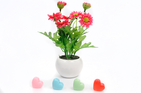 artificially: Red flowers in white flower pot with heart, artificially