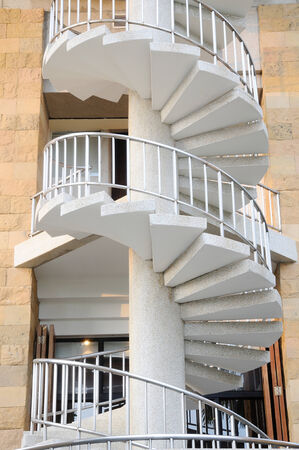 White winder stairs with stainless steel handrail