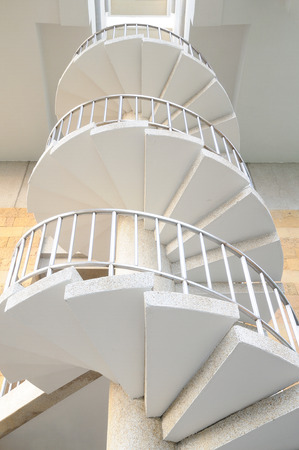 White winder stairs with stainless steel handrail photo