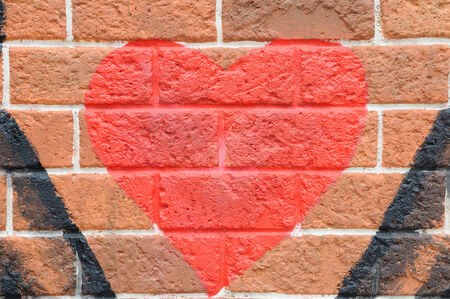 Red heart on red brick wall, love concept photo