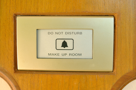 Electric warning sign on wood plate, DO NOT DISTURB and MAKE UP ROOM photo