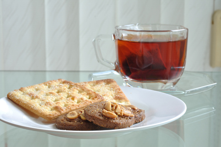 Cup of tea with cookie and bread, tea-break. photo