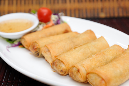 Fried spring rolls on white plate. photo