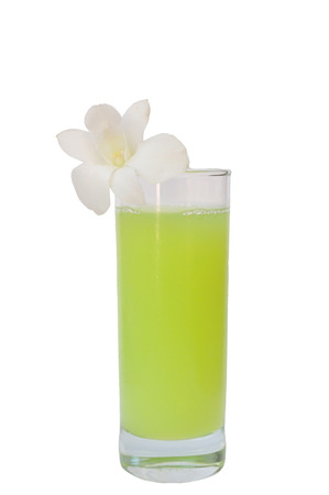 Glass of guava juice with white plumeria photo