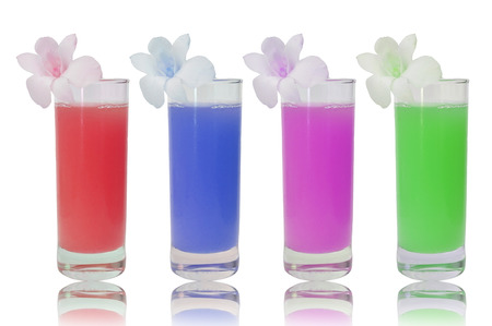 4 glasses of various fruit juices on white background photo