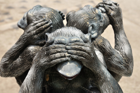 evil: Three wise monkeys or Three Mystic Apes sacred ancient icon