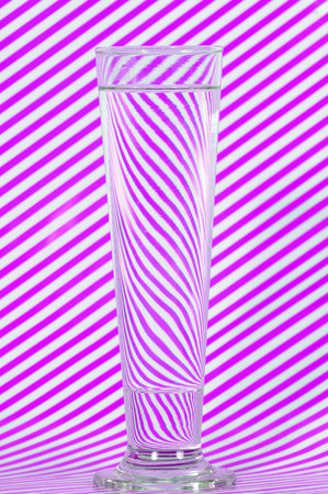 lining: Water in glass with violet lining Stock Photo