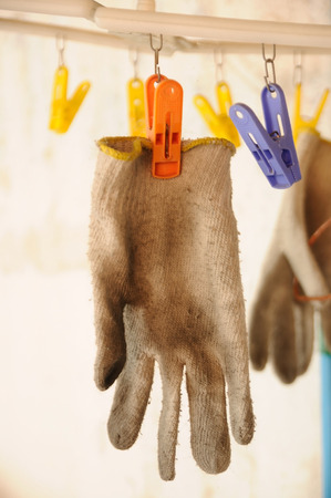 clothes pin: Dirty gloves hanging with clothes pin.