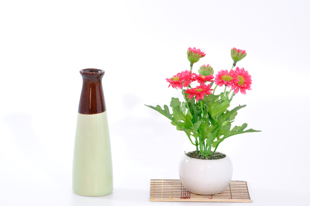 bamboo mat: Colorful flower with vase on bamboo mat. Stock Photo